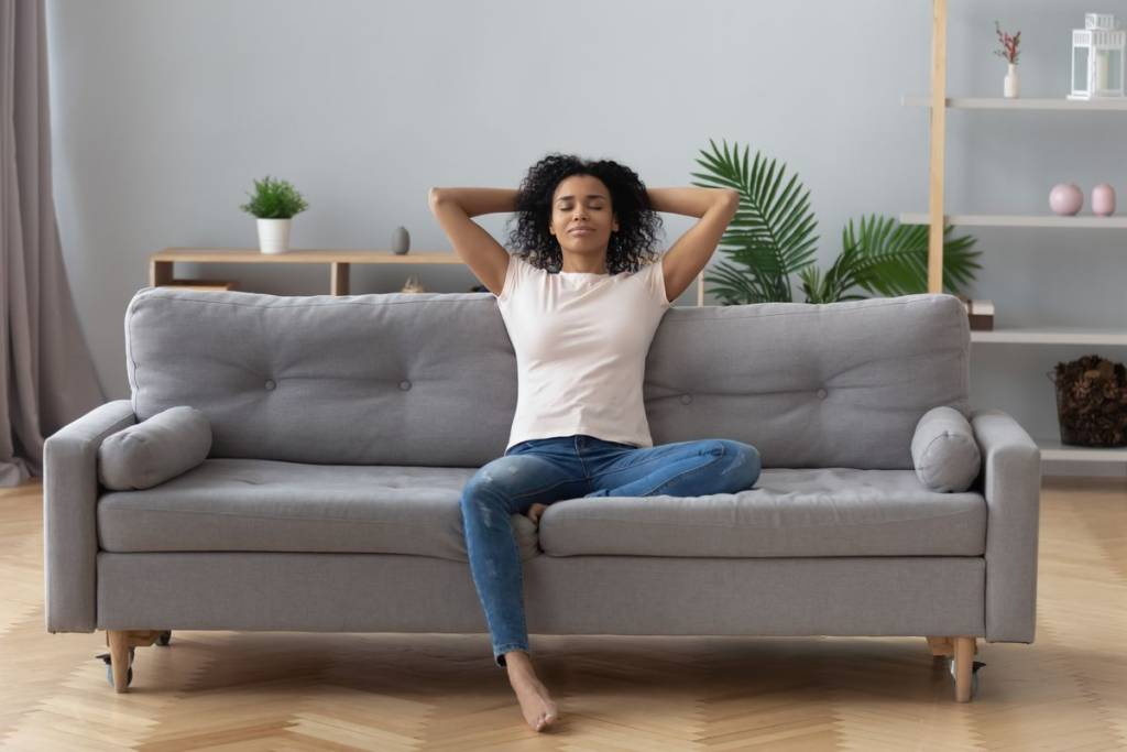 Woman relax sofa breath