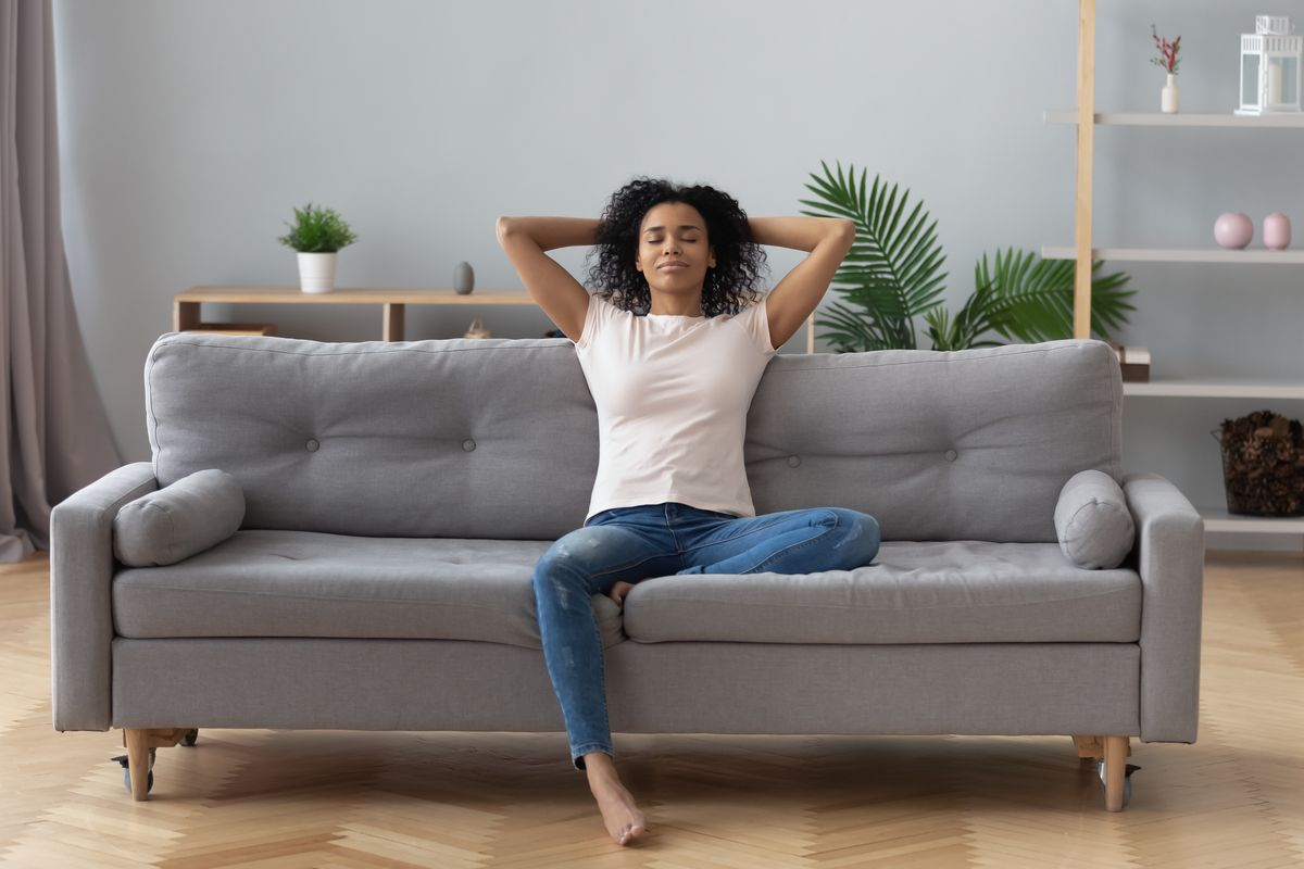 Woman breathes on the sofa