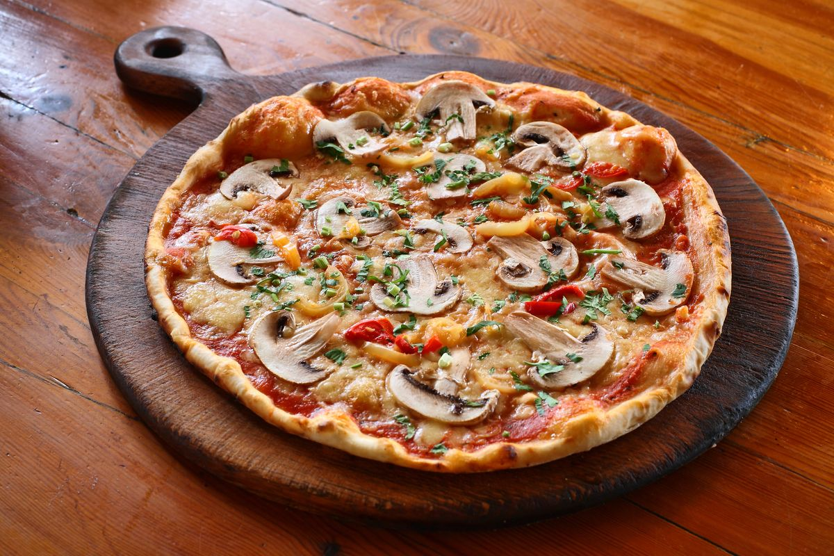 Gluten free pizza with mushrooms