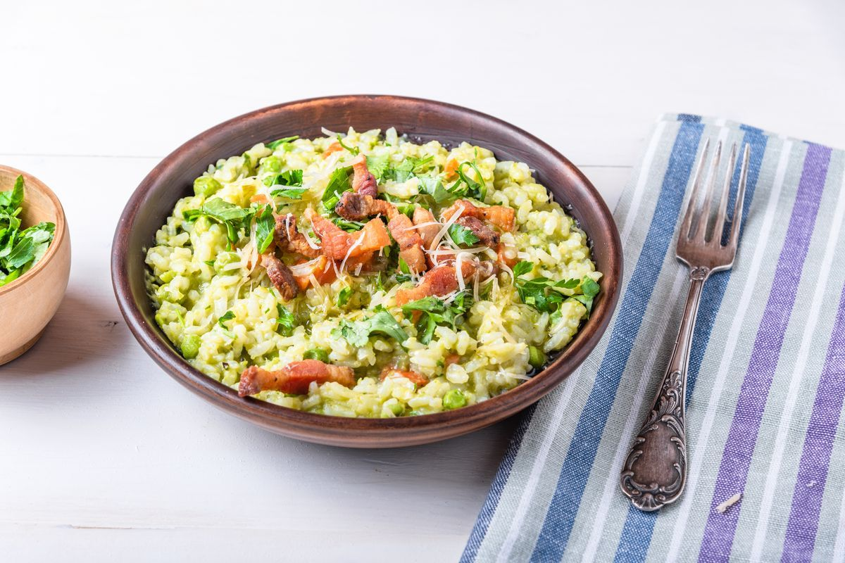 Spinach risotto with raw ham and provolone